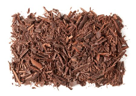 Chopped brown chocolate on white