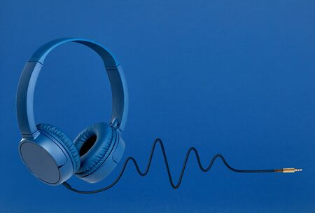 Headphones with pulse cable on blue