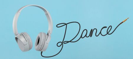 Headphones with dance cable on blue background