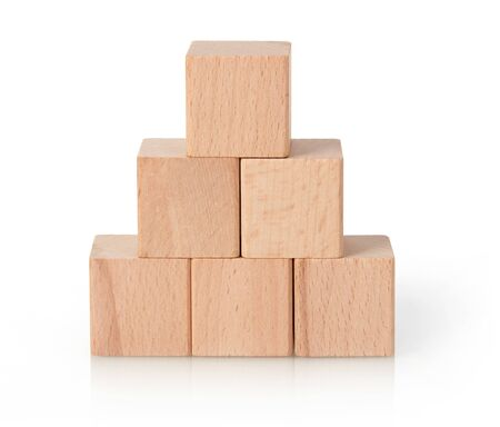 Wooden cubes pyramid on white