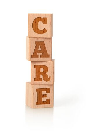 Care word on wooden cubes, white background