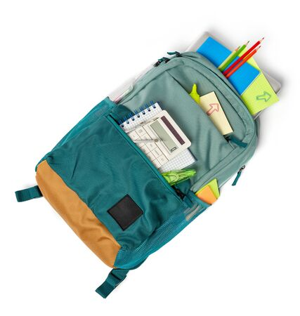 Backpack with supplies on white background