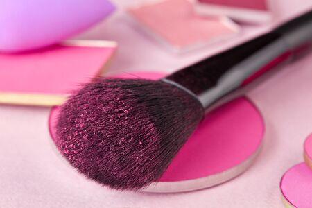 Makeup brush close-up on pink