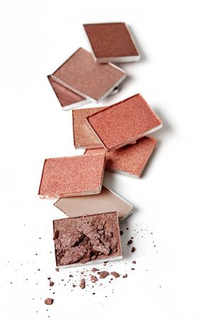 Brown face powders on white