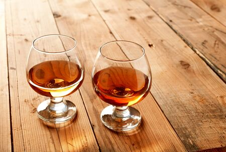 Whisky glasses on wooden table