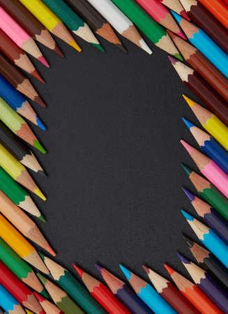 Multi-colored pencils on black background