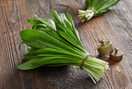 Wild garlic leafs on wood table