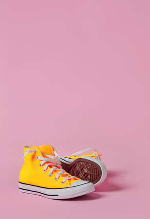 Sport canvas shoes on pink background