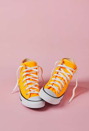 Old style sport sneakers on pink background