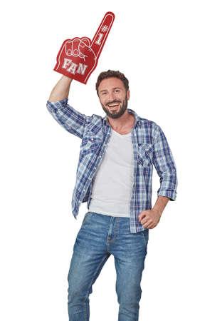 Cheerful man with fan foam hand 免版税图像