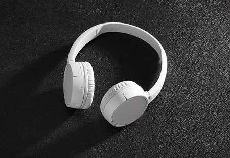 White headphones on black background