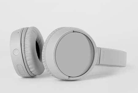 Wireless gray headphones on gray background