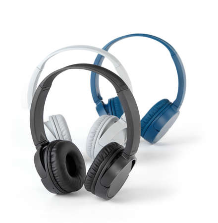 Black, gray and blue headphones on white background