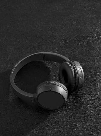 Black headphones on black background