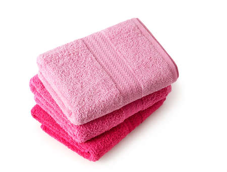 Fluffy pink towels on white background