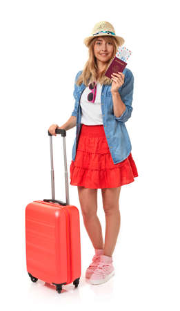 Summer dressed girl with suitcase, passport and airplane tickets