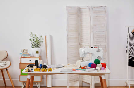 Dressmaker's workshop with copy space