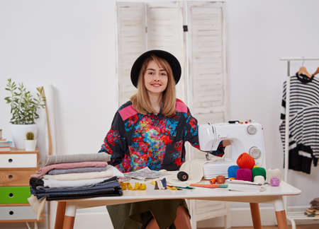 Young fashion designer at the worktable