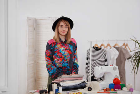 Young fashion designer with textiles