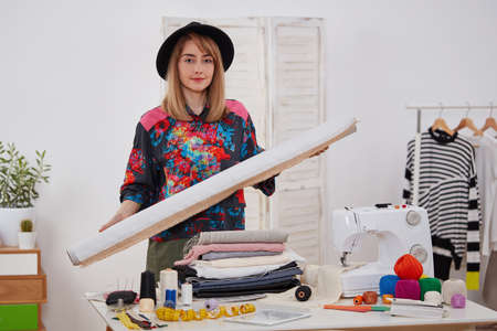 Young fashion designer with textile