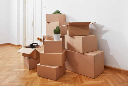 Cardboard boxes in a room Stock Photo