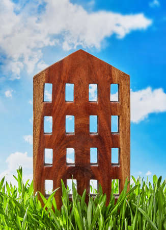 Wooden house structure in grass