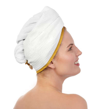Young woman in white towel wrapped around head
