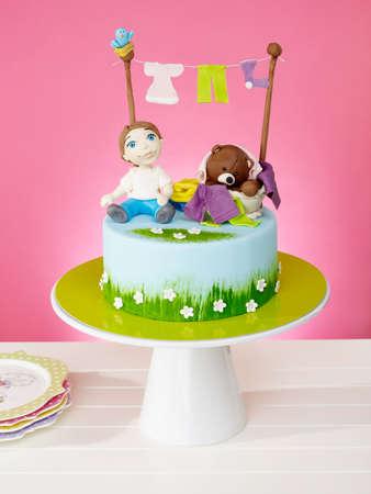Beautiful kid's birthday cake on pink