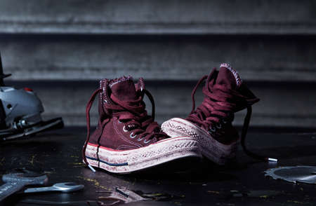 Used canvas shoes on dark background