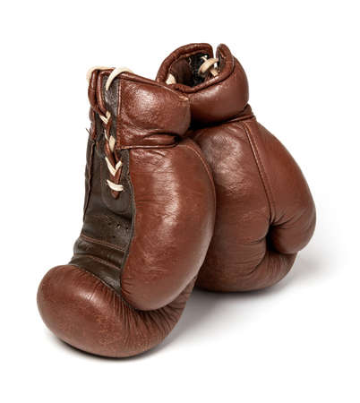 Used boxing gloves on white background