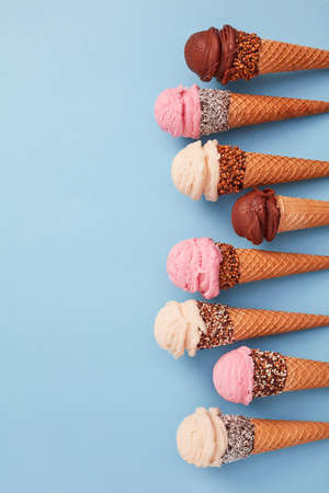 Homemade ice cream cones on blue background