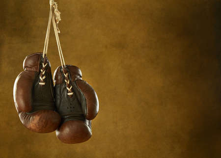 Old boxing gloves hanging on a wall