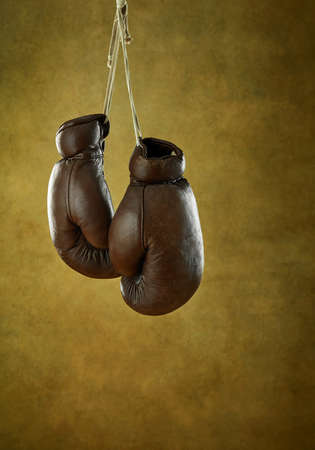 Old leather boxing gloves on a wall