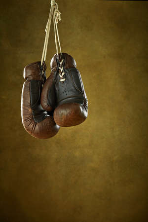 Used leather boxing gloves on a wall 免版税图像