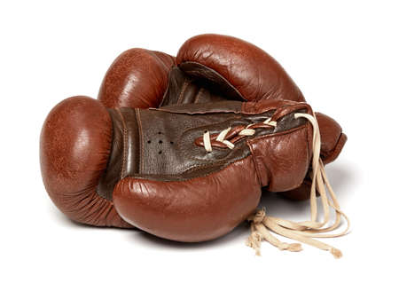 Old boxing gloves on white background