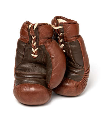 Old leather boxing gloves on white background 免版税图像