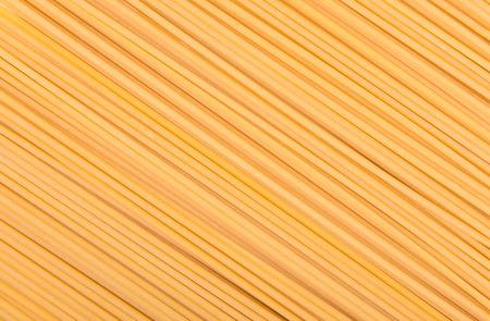 raw pasta on wood background