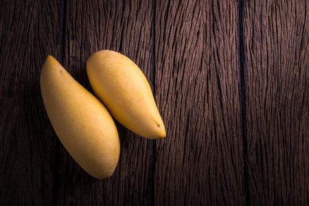 mango ripe on wooden background