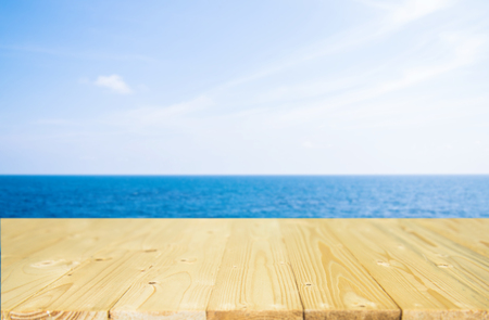 Wood table top on blue sea  sky background can put or montage your products for display
