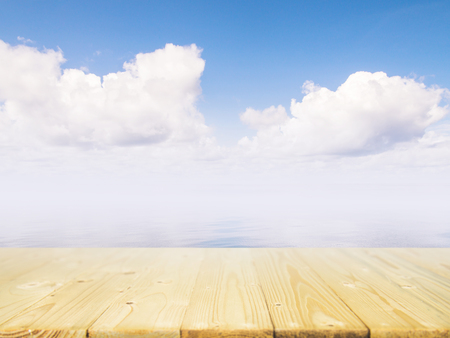 Wood table top on blue sea  sky background can put or montage your products for display.