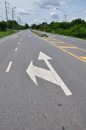arrow traffic symbol on the road Stock Photo - 7389007