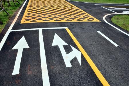 turn arrow traffic and cross line symbol photo