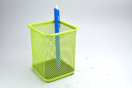 green basket and blue pen photo