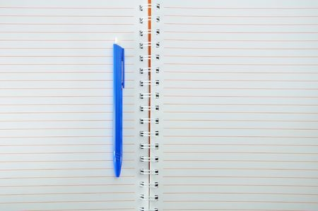 Empty notebook and blue pen Stock Photo - 7651592