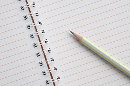 Blank notebook and pencil as white isolate background photo