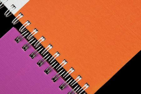 Colorful notebook as black background