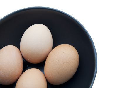 egg on black cup as white isolate background Stock Photo - 8050789