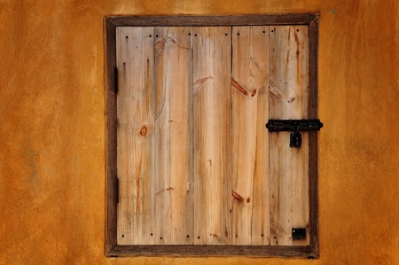 wooden window as color wall photo