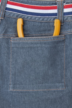 Nipper put in back pocket view of jeans photo