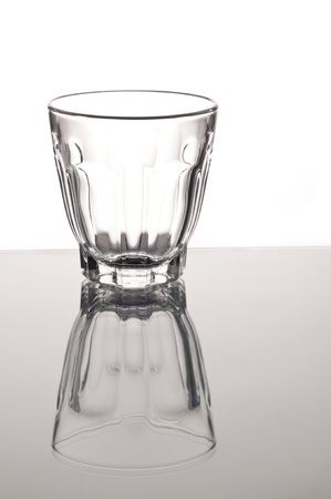 empty small whisky glass as white isolate background photo